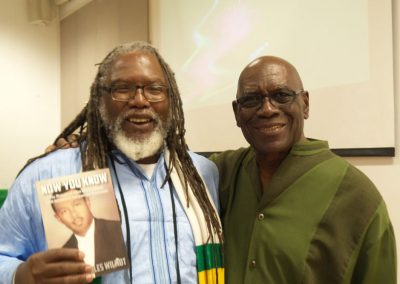 Glenroy Watson with his copy of Mr Wilmot's Autobiography and our Secretary